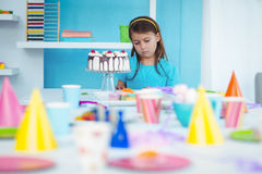 Sad kid alone at her birthday Royalty Free Stock Images