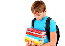 Sad Kid with a Books. Sad Kid with the Books Isolated on the White Background Royalty Free Stock Photography