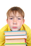 Sad Kid with a Books Royalty Free Stock Photo