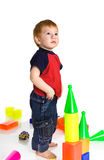 Sad kid with cubes. Redheaded sad kid with cubes Stock Photo