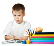 Sad kid is doing his homework Stock Photography