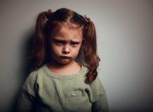 Sad kid girl with long hair. Closeup vintage Royalty Free Stock Photos