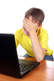 Sad Kid with Laptop Royalty Free Stock Images