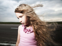 Sad kid near road Royalty Free Stock Photos