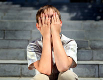 Sad Kid outdoor. Stressed Kid on the City Street closeup Royalty Free Stock Photos