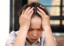 Sad Kid outdoor. Stressed Teenager on the City Street closeup royalty free stock photography