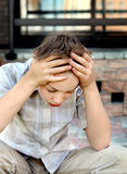 Sad Kid outdoor. Sad and Troubled Kid sit outdoor royalty free stock photography