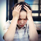 Sad Kid outdoor. Vignetting Photo of Sad and Troubled Kid outdoor Royalty Free Stock Photography