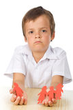 Sad kid with paper people in hands Royalty Free Stock Photography