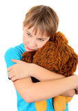 Sad Kid with a Plush Toy Royalty Free Stock Photos