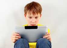 Sad Kid with Tablet Royalty Free Stock Photo