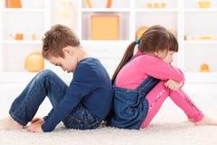 Sad kids Stock Photos