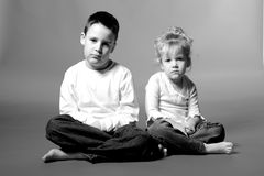 Sad kids. Sad boy and girl in black and white stock photography
