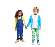 Sad kids. Sulky kids in casual-wear holding by hands stock image