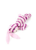Sad knitted rabbit toy lays isolated on white Stock Photography