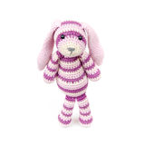 Sad knitted rabbit toy stands over white background Stock Images