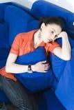 SAD kvinna för soffa Royaltyfri Bild
