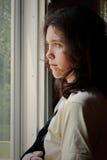 SAD kvinnabarn för missbruk Royaltyfria Bilder