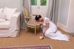 Sad lady in antique dress stock photo