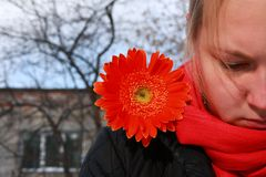 Sad lady with flower. On her shoulder Royalty Free Stock Photography