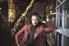 Sad Lady in leather standing outside night city Stock Photography