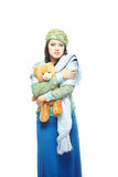 Sad lady with toy. Sad young lady holding the toy on a white background Stock Photography