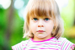 Sad liitle girl Stock Photos