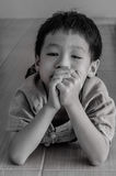 Sad little Asian boy Royalty Free Stock Photos