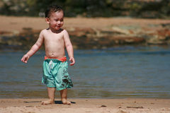 Sad Little Boy on Beach Stock Images