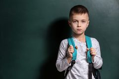 Sad little boy being bullied at school. On color background stock images