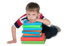 Sad little boy with books Royalty Free Stock Images
