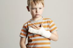 Sad little boy.child with a broken arm Royalty Free Stock Image