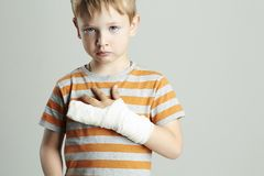 Sad little boy.child with a broken arm Stock Photo