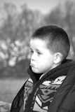 Sad little boy in the countryside Stock Images