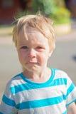 Sad little boy Stock Photos