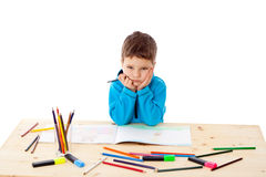 Sad little boy draw with crayons Royalty Free Stock Images