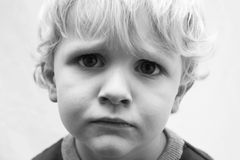 Sad Little Boy. Little boy with a sad face black and white Stock Photo