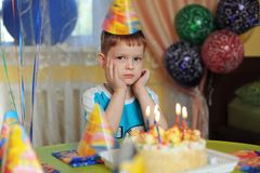 Little boy in family birthday party. Royalty Free Stock Photo
