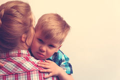 Sad little boy hugging his mother at home. Cropped shot of little caucasian boy hugging his mother after sorrow at home. Family relations concept. Copyspace royalty free stock photography