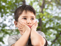 Sad little boy looking at something Royalty Free Stock Image