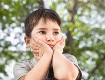 Sad little boy looking at something Royalty Free Stock Image