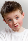 Sad little boy looking to camera royalty free stock photo