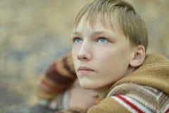 Sad little boy outdoors in autumn. Portrait of a sad little boy outdoors in autumn Stock Photography