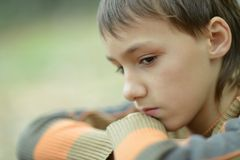 Sad little boy outdoors in autumn Stock Photos