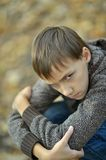Sad little boy outdoors in autumn Royalty Free Stock Photos