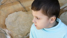 Sad little boy outdoors stock video footage