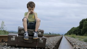 Sad little boy outdoors at the day time. stock video