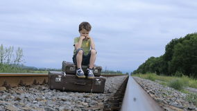 Sad little boy outdoors at the day time. stock footage