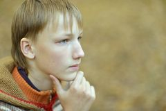 Sad little boy outdoors. Portrait of a sad little boy outdoors in autum Royalty Free Stock Photography