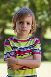 Sad little boy in the park Royalty Free Stock Photo